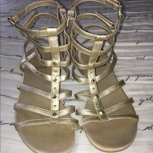 Gold ankle high sandals